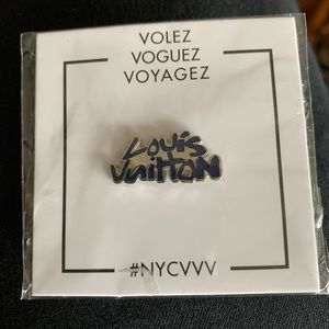 Louis Vuitton pin silver with Navy lettering